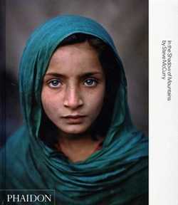 STEVE McCURRY. IN THE SHADOW OF MOUNTAINS
